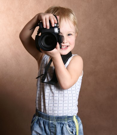 child in studio with professional camera Stock Photo - 7931684