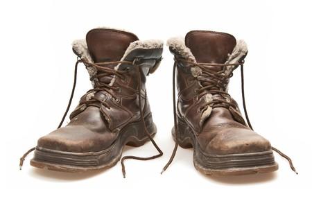 untied: viejos botas marr�n aislados en blanco  Foto de archivo