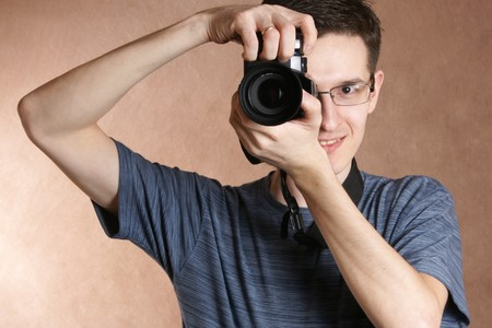 photographer, young man with professional camera photo