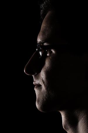 portrait of man in black photo