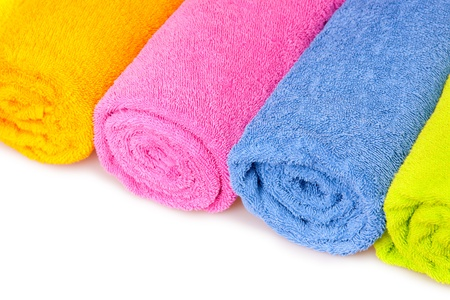 orange washcloth: color towels isolated on white