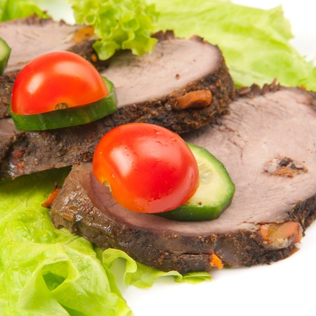 three peaces of meat with vegetables Stock Photo - 9719280
