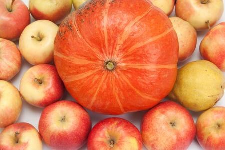 orange pumpkin with apples, background photo