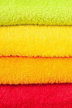 orange washcloth: color convolute towels Stock Photo