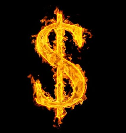 burning money: fire sign dollar on black Stock Photo