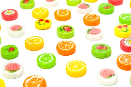 many differnt tasty candies on white photo