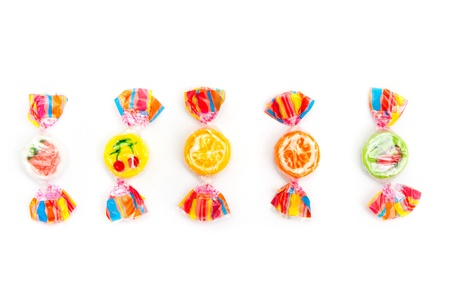 five different candies on white photo