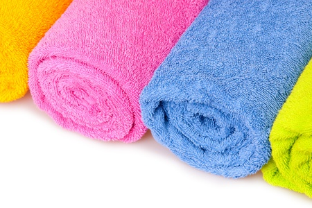 color towels isolated on white photo