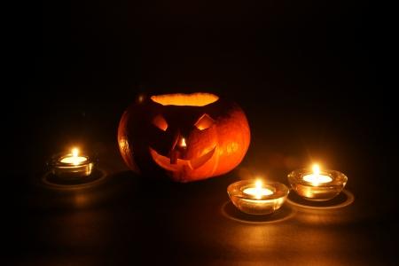 cucurbit: lantern, illuminating pumpkin in dark night Stock Photo