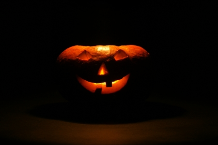 lantern, illuminating pumpkin in dark night photo