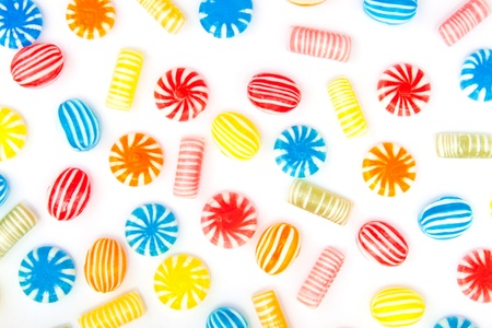 many different color candies on white Stock Photo - 18702077
