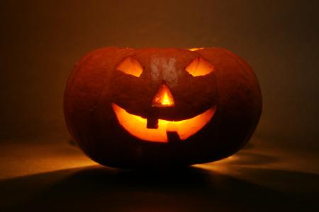 lantern, illuminating pumpkin in dark night photo