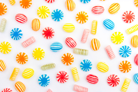 candy: many different color candies on white