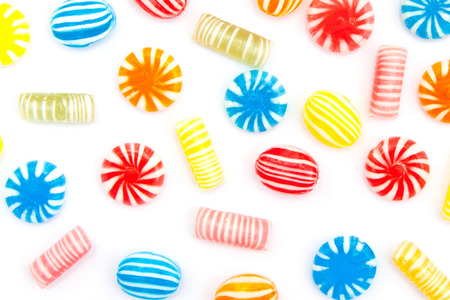 sugarplum: many different color candies on white