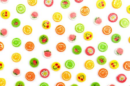 many differnt tasty candies on white