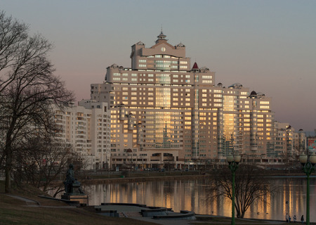 svisloch: View of the city Minsk and a river Svisloch at sunset with a clean sky and reflection of the lights in the building and water. Stock Photo