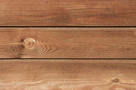 pine three: Three brown treated pine wood plank overlapped horizontal.