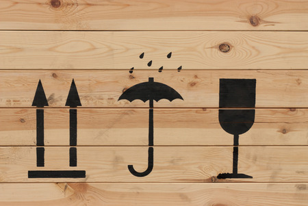 Packaging symbols this way up, keep dry and fragile on wood photo