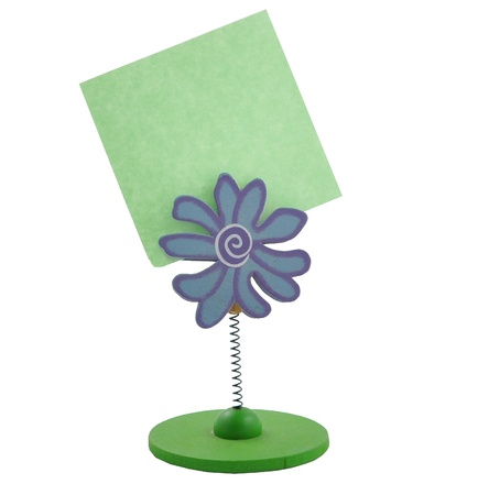 sign holder: Green note paper on white background holder flowers  Stock Photo