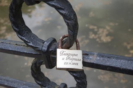 love confession: Photo decorative lattice the lock an inscription love Stock Photo