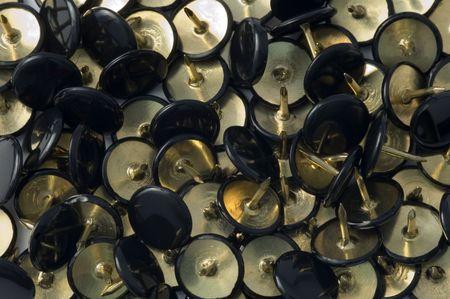 lots of black & gold thumbtacks photo