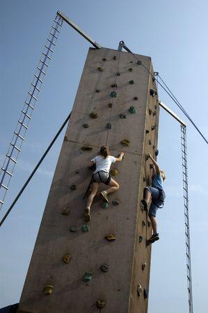 2 kids climbing a wall against blue sky Stock Photo - 413668