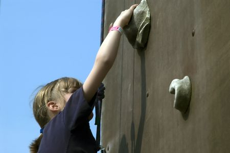 climbing girl reaching for a grip on the wall Stock Photo - 413650