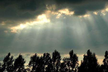 peaking: Sun peaking through the clouds Stock Photo