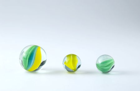 three marbles isolated on white backdrop