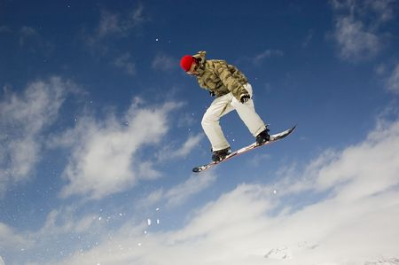 snowboarder jumping high in the air photo