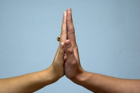 tact: male and female hand touching each other