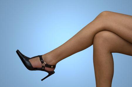 female legs isolated on blue background photo