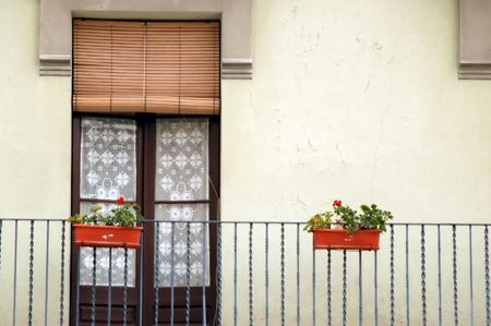 balcony with door and flowers in spain photo