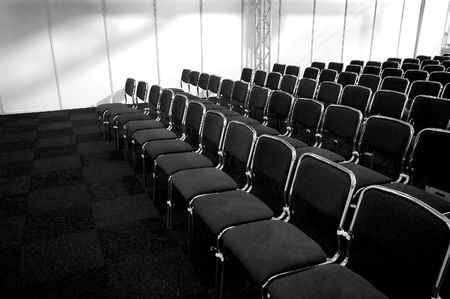 blackwhite picture of black business chairs, ready for a conference Stock Photo