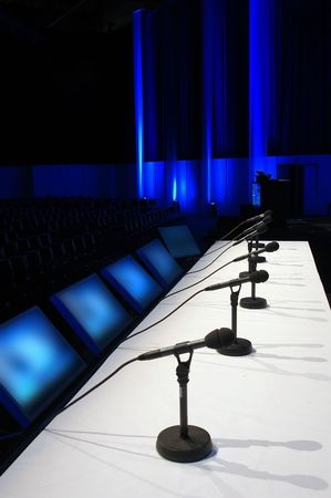 business event: conference room with microphones on the table Stock Photo