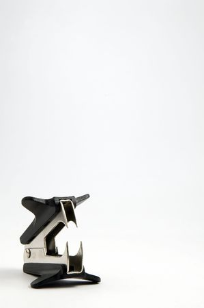 detach: staple remover isolated on white background, vertical