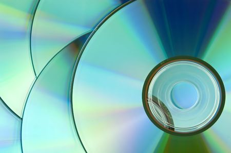 dvdr: background of some colorful compact discs Stock Photo