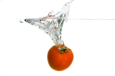 dropping a tomato in water