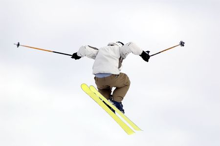 a snowboarder jumping high through a white sky Stock Photo
