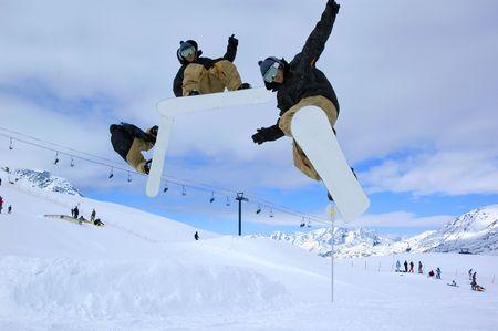 a serie of a snowboarder jumping high through a blue sky