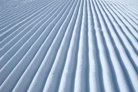 diverging: lines in the snow made by a snowmobile Stock Photo