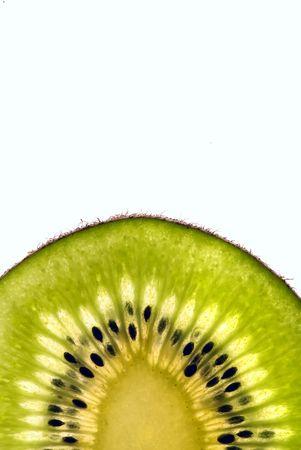 lushes green slice of a kiwi isolated on white background photo