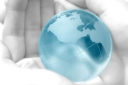 hand holding a blue globe, blurred, dreamy atmosphere Stock Photo