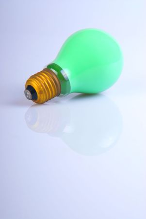 a green lightbulb over white with reflection Stock Photo - 915743