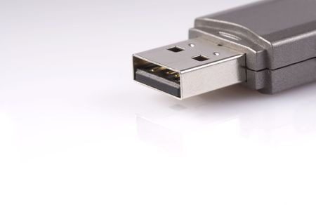 micro drive: close-up of usb stick with reflection, isolated over white