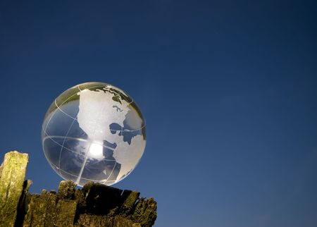 a crystal globe over blue sky photo