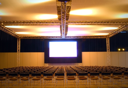 lots of chairs in front of a screen, ready for the public