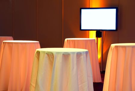 flatscreen: Tables and a flatscreen TV in a business-like environment. Stock Photo