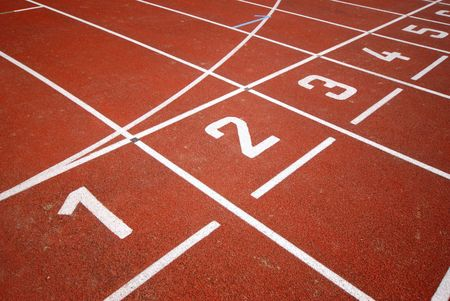 racetrack: numbers of a racetrack, on red tarmac, for runners