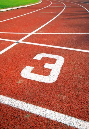 number three of a racetrack, on red tarmac, for runners.  photo